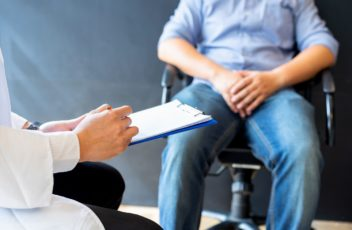 Male doctor and prostate cancer patient are discussing about prostate cancer test report. Diagnostic, prevention of men diseases, healthcare, medical service, consultation, healthy lifestyle concept.
